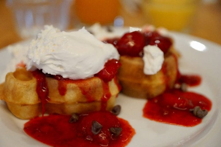 Cape May Cafe Breakfast Review mickey waffles strawberries and whipped cream low close