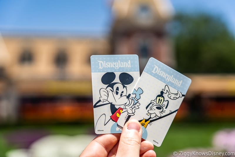 Disneyland Tickets in hand in front of Train Station