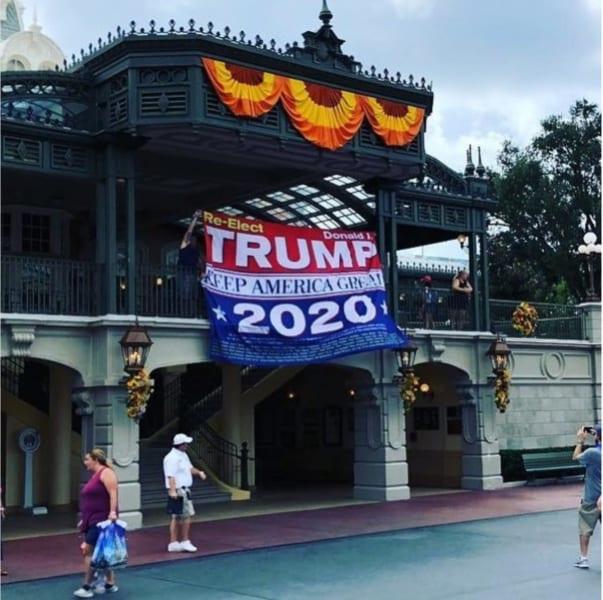 Man Hangs Donald Trump 2020 Banner on Main Street