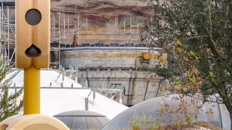 Star Wars Galaxy's Edge Construction Update December 2018 theming above Millennium Falcon