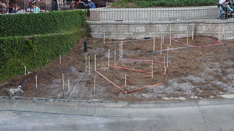 pathway behind Cinderella Castle construction update march 2019 stakes for walkway