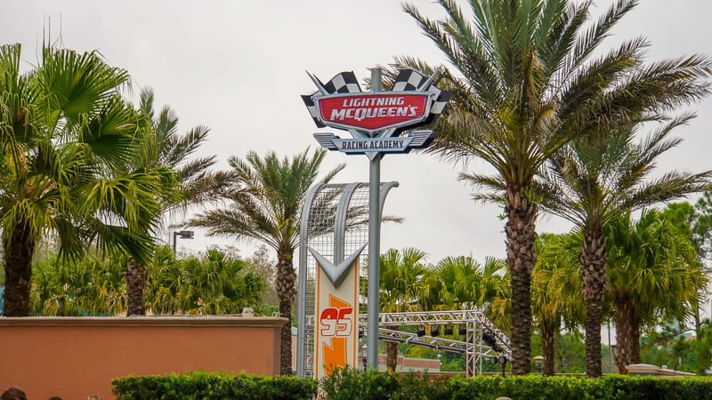 Lightning McQueen's Racing Academy Construction Update March 2019 tall shot of attraction sign