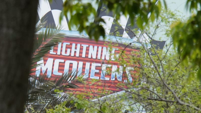 Lightning McQueen's Racing Academy Construction Update March 2019 close up of sign through the trees