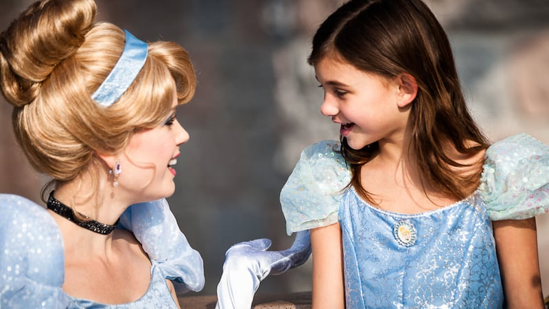 Cinderella's Royal Table Signature Celebration Package Cinderella with a little girl