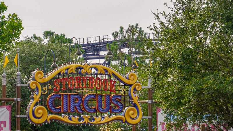storybook circus with TRON roller coaster in background