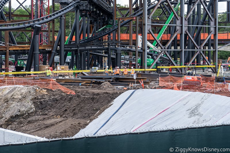 workers on ground TRON Lightcycles Run roller coaster update august 2019