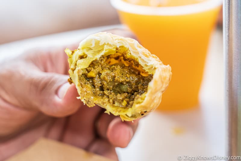 Nigerian Meat Pie inside Refreshment Outpost 2019 Epcot Food and Wine Festival