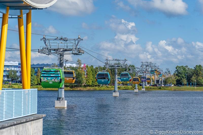 Lots of Disney Skyliner Gondolas over water at Pop Century Art of Animation