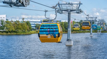 Gondolas over water at Disney Skyliner Gondola Stations Pop Century Art of Animation