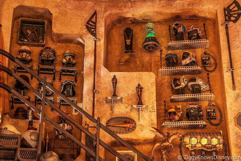 Wall of helmets in Dok Ondar's Den of Antiquities Galaxy's Edge