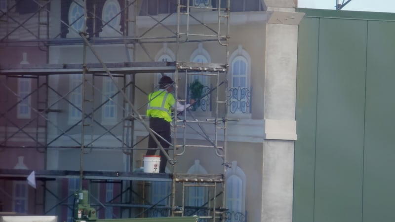 painting a plant and window on Ratatouille ride facade