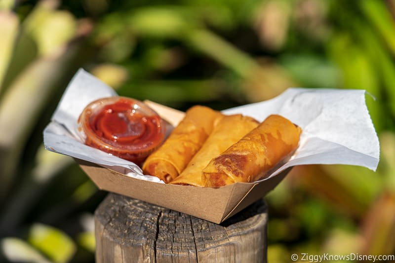 cheeseburger and pepperoni spring rolls in adventureland Best Snacks at Magic Kingdom