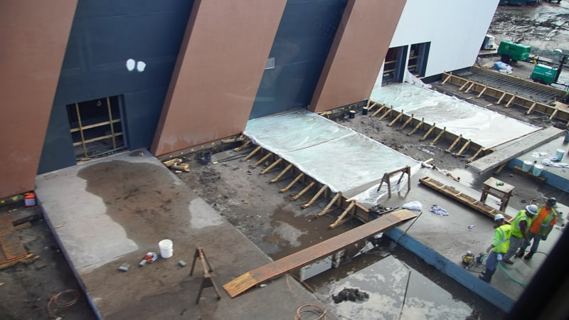 concrete being poured on the side of outside the building Guardians of the Galaxy coaster