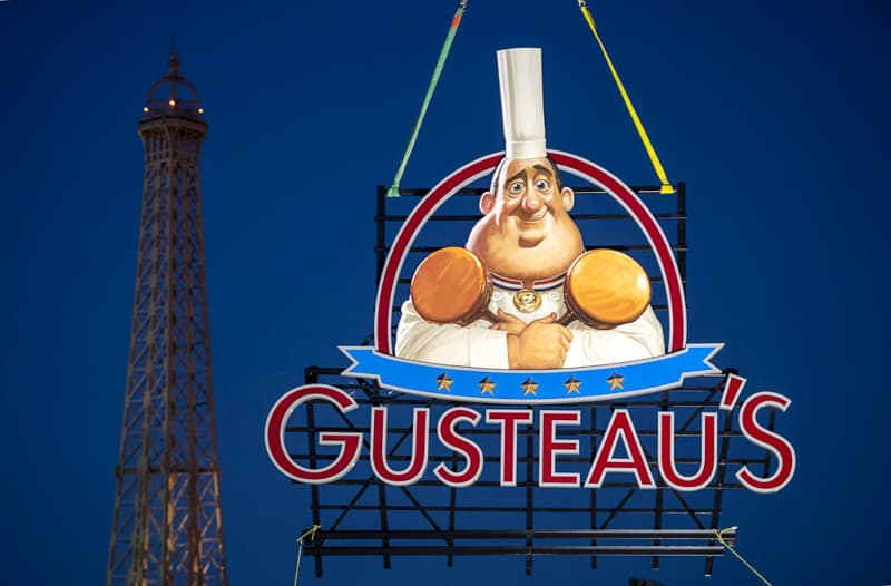 Gusteau's Sign Epcot France pavilion at night