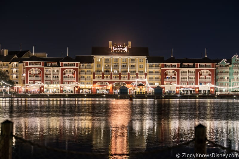 Disney's Boardwalk Resort at night over the lake