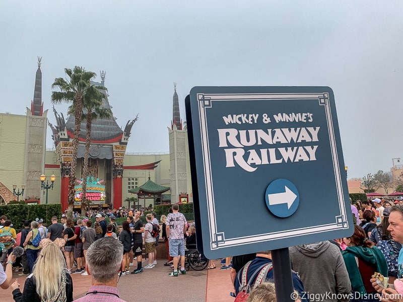 Sign for Mickey and Minnie's Runaway Railway queue