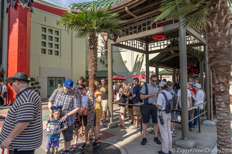 guests in queue outside Mickey and Minnie's Runaway Railway