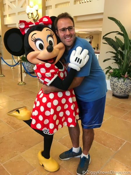 Getting hug from Minnie Mouse Disney Check-In