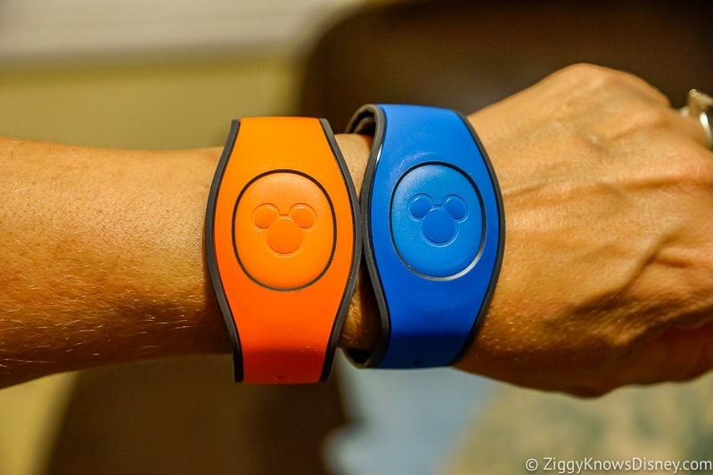 Blue and orange MagicBands on wrist