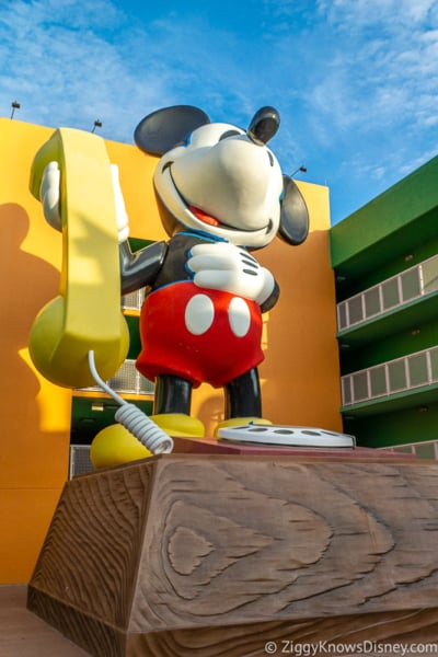 Giant Mickey Mouse statue with telephone in Disney World