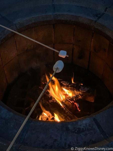 Cooking marshmallows at campfire in Walt Disney World Resort