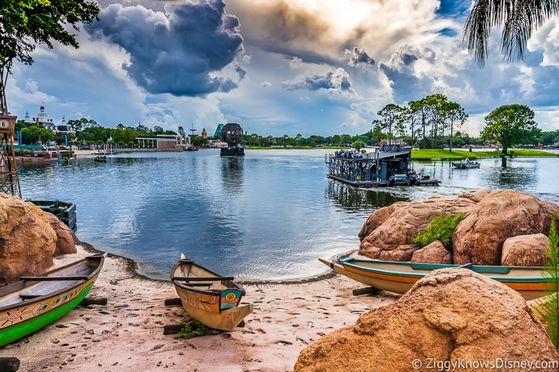 View of World Showcase Lagoon EPCOT with canoe on the beach