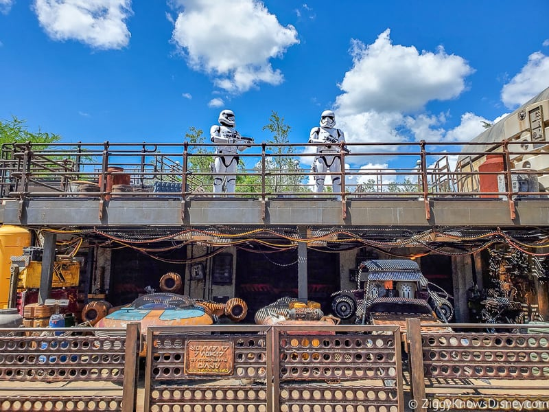 Stormtroopers on top of platform above speeders in Galaxy's Edge