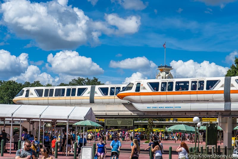 two monorails passing each other at Magic Kingdom entrance