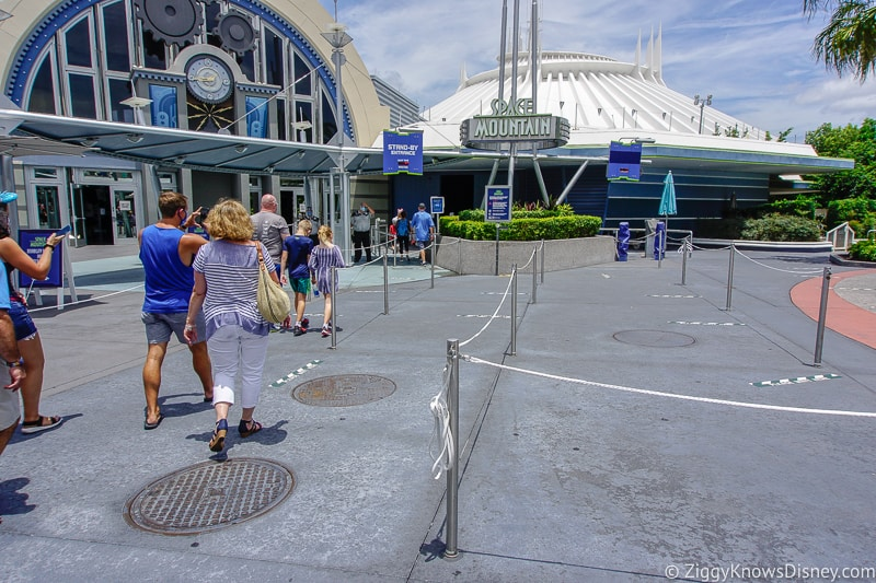 Crowds walking to Space Mountain at opening