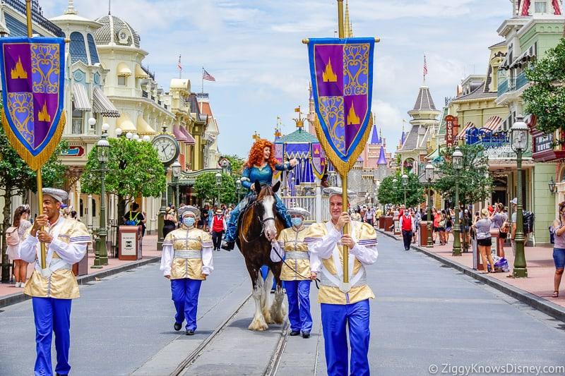 Merida riding a horse down Main Street U.S.A. Magic Kingdom opening