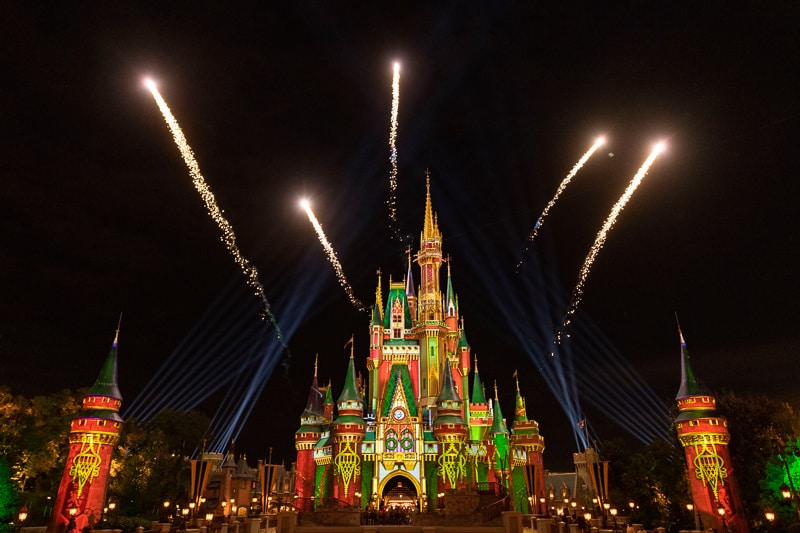 fireworks during Magic Kingdom holiday projection show