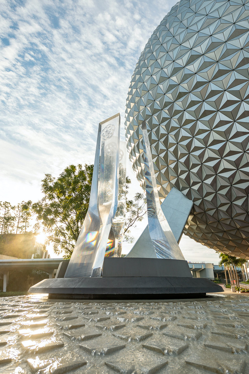 EPCOT Entrance Fountain with the sun and Spaceship Earth