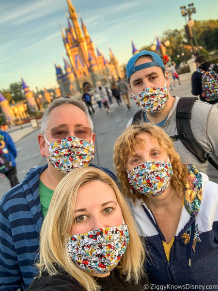in front of Cinderella Castle Magic Kingdom with masks
