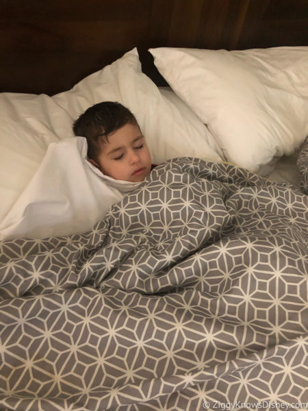 toddler sleeping in bed at Disney World