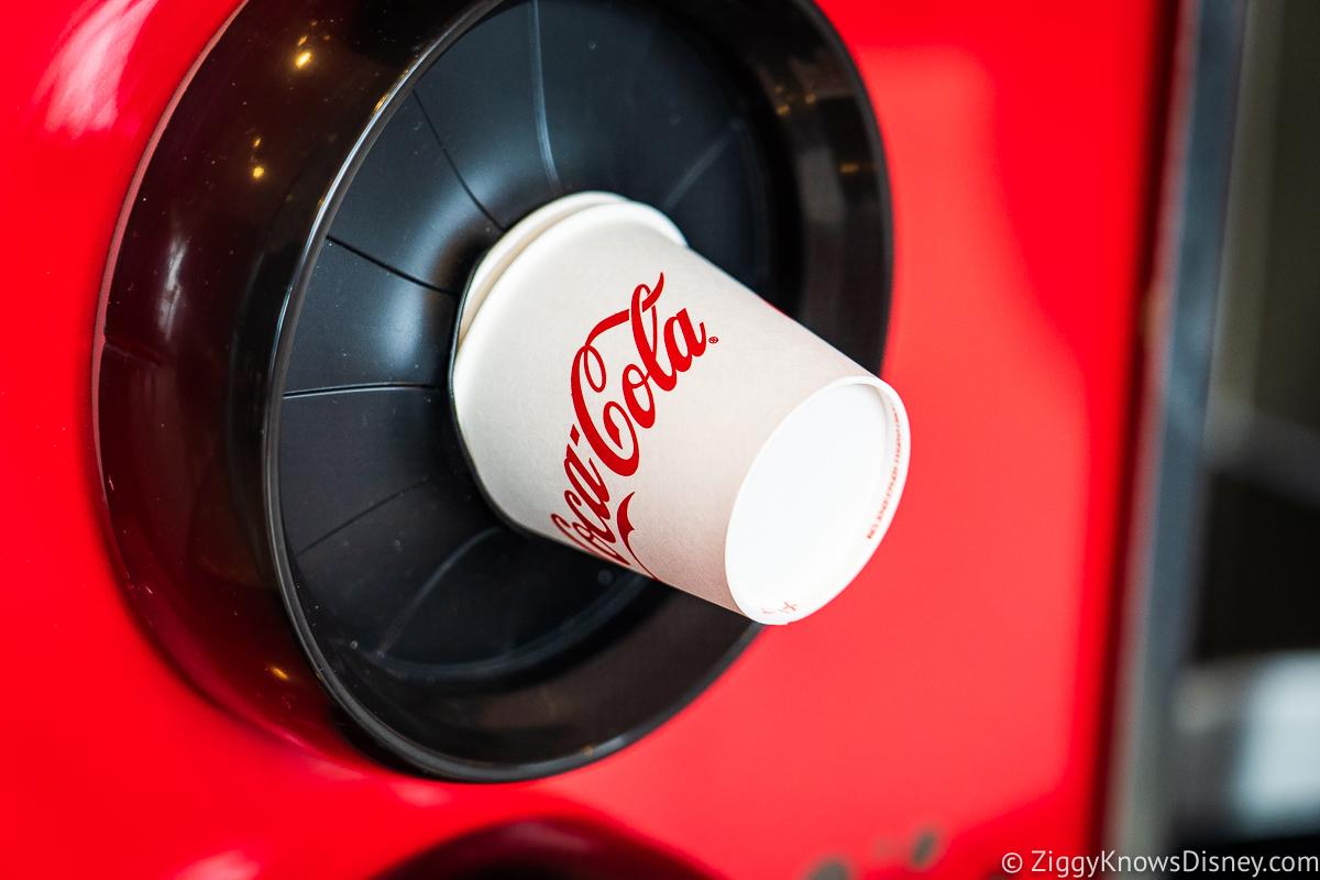Cups next to soda machine