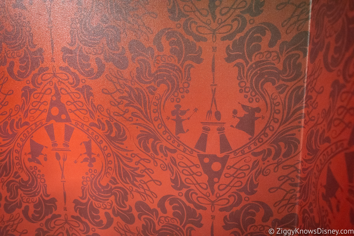 Red wall with Remy on it